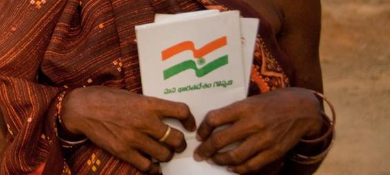 Woman holding land title in Andhra Pradhesh, India
