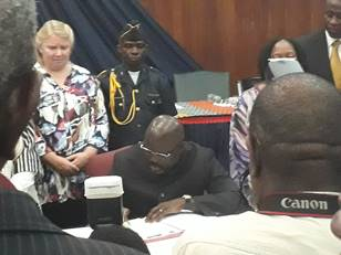 President George Weah signing Land Rights Act